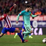 Atletico Madrid's Montenegrin defender Stefan Savic (L) tackles Barcelona's Argentinian forward Lionel Messi during the Spanish Copa del Rey (King's Cup) semi final first leg football match Club Atletico de Madrid vs FC Barcelona at the Vicente Calderon stadium in Madrid on February 1, 2017. / AFP PHOTO / JAVIER SORIANO