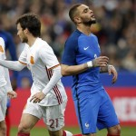 France's Layvin Kurzawa, 2nd right, reacts as Spain's scorer David Silva, 2nd left, and his teammate Gerard Deulofeu, left, celebrate the opening goal during the international friendly soccer match between France and Spain at the Stade de France in Paris, France, Tuesday, March 28, 2017. (AP Photo/Christophe Ena)