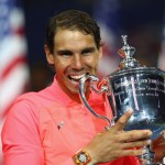 NEW YORK, NY - SEPTEMBER 10:  Rafael Nadal of Spain bites the championship trophy during the trophy ceremony after their Men's Singles Finals match on Day Fourteen of the 2017 US Open at the USTA Billie Jean King National Tennis Center on September 10, 2017 in the Flushing neighborhood of the Queens borough of New York City. Rafael Nadal defeated Kevin Anderson in the third set with a score of 6-3, 6-3, 6-4.  (Photo by Clive Brunskill/Getty Images)